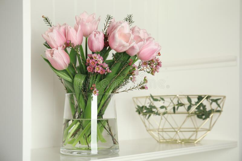 Beautiful bouquet with spring pink tulips on shelf royalty free stock photos