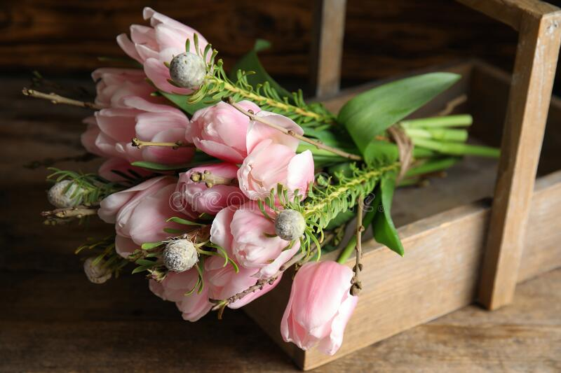 Beautiful bouquet of spring pink tulips on wooden table, closeup stock images