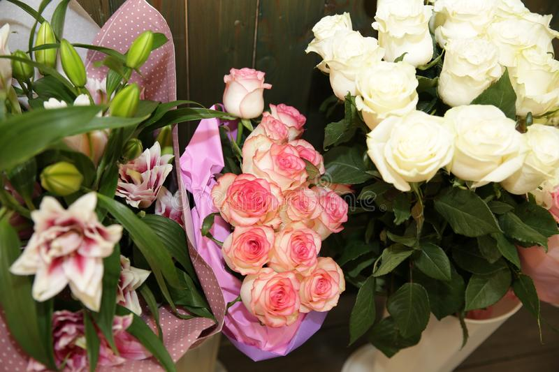 Beautiful bouquet of white and pink roses and lilies.. royalty free stock photo