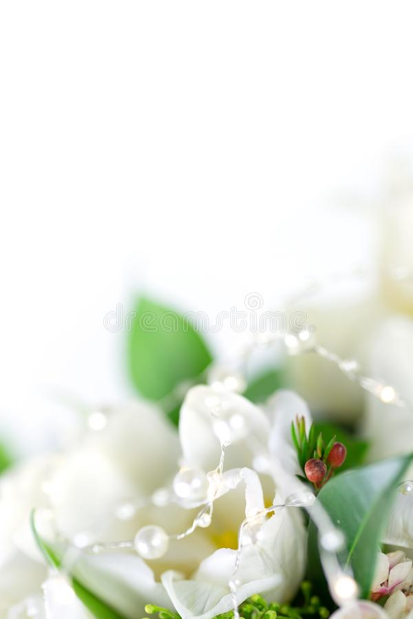 Beautiful bouquet of white tulips with green leaves and other decorative flowers close up. Beautiful bouquet of white tulips with green leaves and other royalty free stock photos