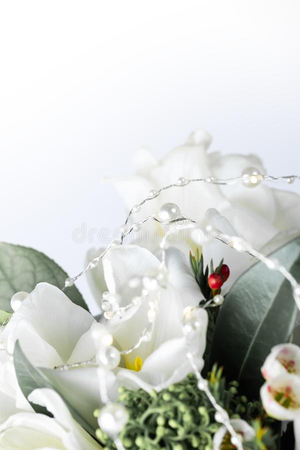 Beautiful bouquet of white tulips with green leaves and other decorative flowers close up. Beautiful bouquet of white tulips with green leaves and other stock photos