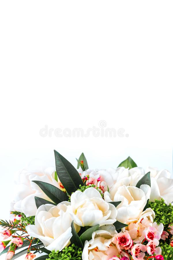 Beautiful bouquet of white tulips with green leaves and other decorative flowers close up. Beautiful bouquet of white tulips with green leaves and other stock images