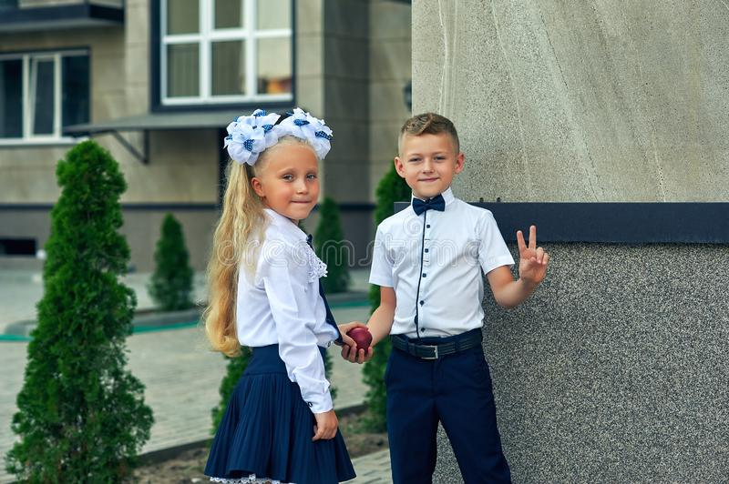 Beautiful boy and girl in school uniform stock image