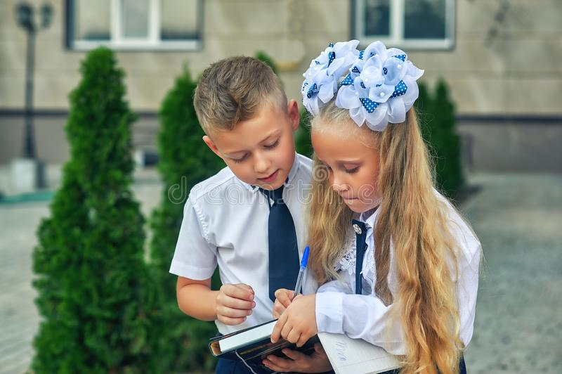 Beautiful boy and girl in school uniform stock photography