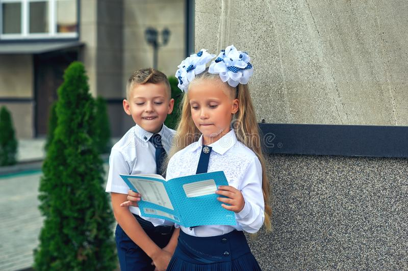 Beautiful boy and girl in school uniform stock photos