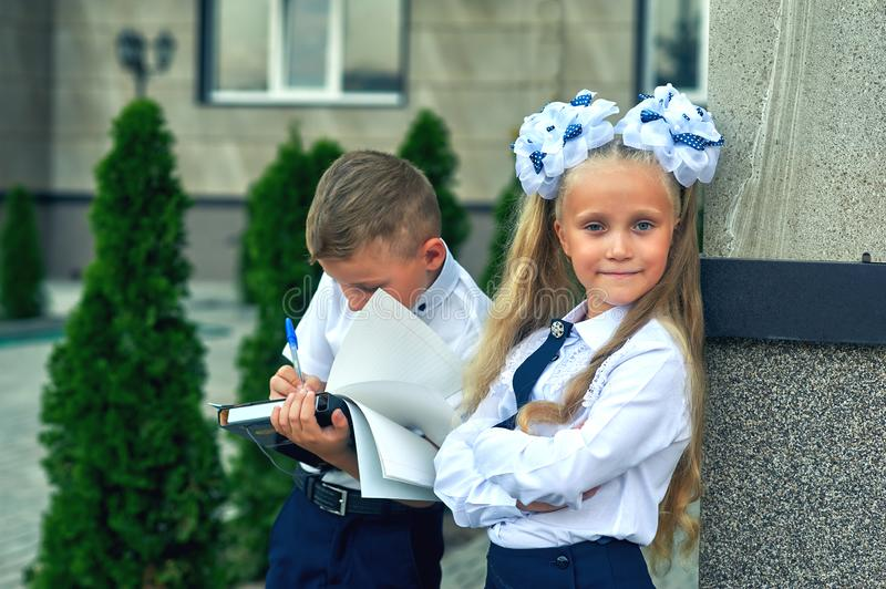 Beautiful boy and girl in school uniform royalty free stock photos