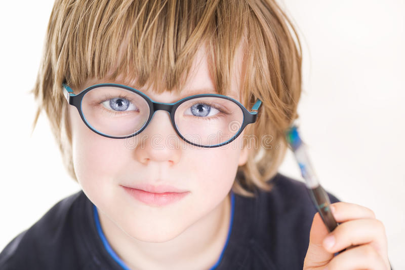 Beautiful boy with glasses and painting brush in hand stock photos