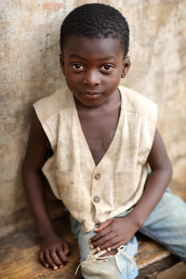 A beautiful boy in a slum in Accra, Ghana. A beautiful boy in a slum near the fishing village Jamestown in Accra, Ghana royalty free stock images