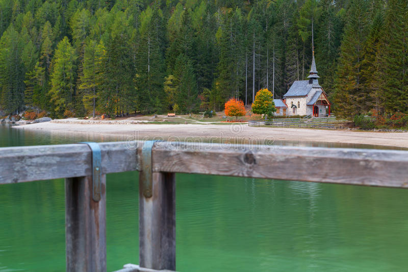 Beautiful Braies lake and church in the background of pine fores. Ts in Dolomites,Italy Pragser Wildsee royalty free stock image