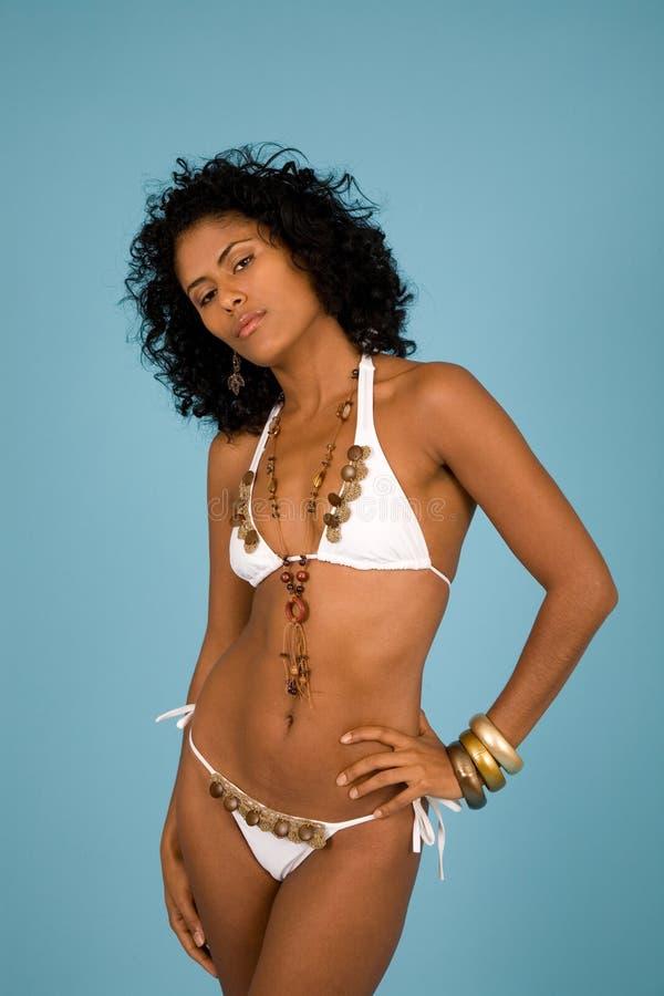 Beautiful brazilian girl. In white bikini on blue background stock images