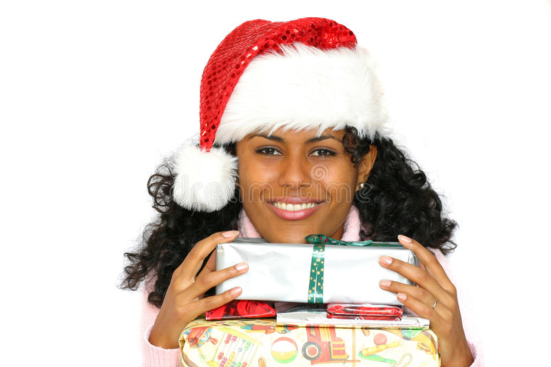 Beautiful brazilian girl with santa hat royalty free stock photos