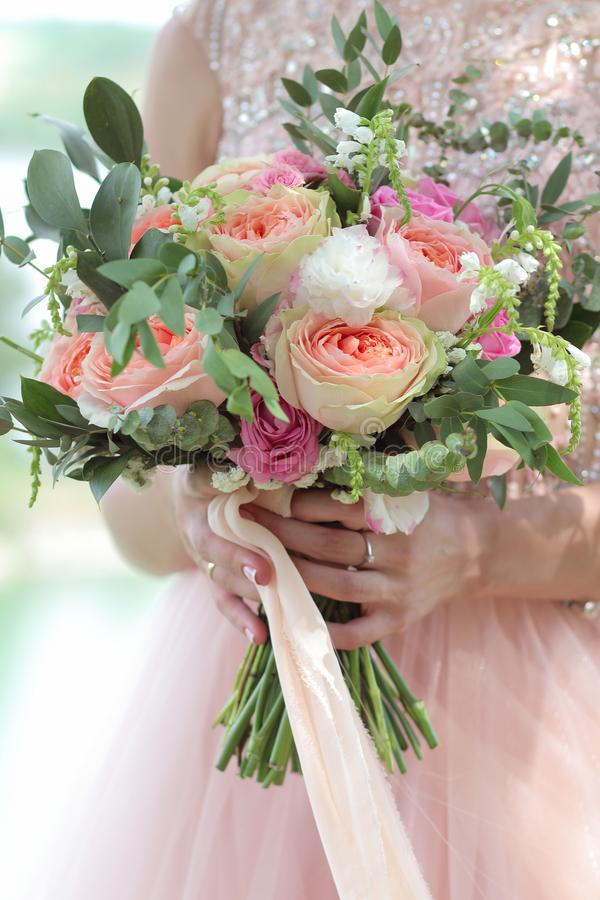 Beautiful Bridal Bouquet In Hands Of The Bride. Wedding Bouquet Of ...