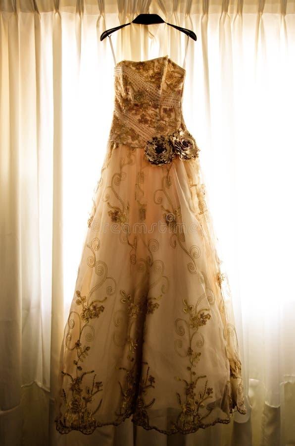 Beautiful Bridal Gown on a window balcony stock photo