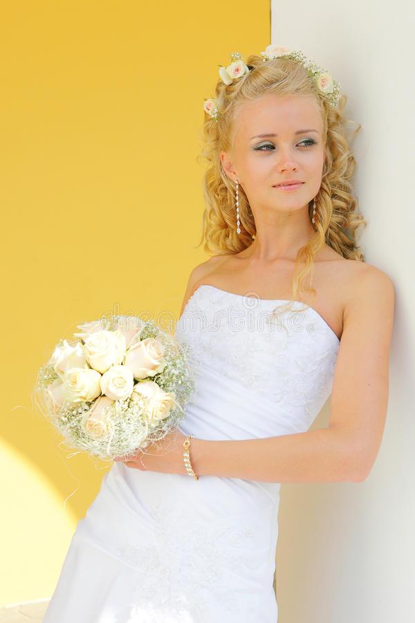 Beautiful bride. Beautiful and happy bride in a wedding dress stock photo