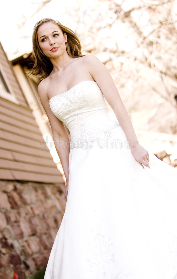 Beautiful Bride. A beautiful bride looking out royalty free stock photography