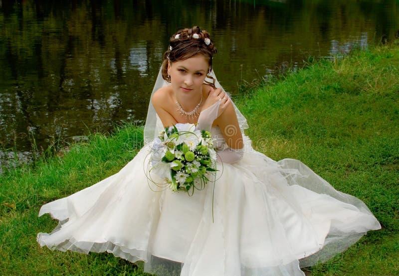 Bride in white dress stock photo