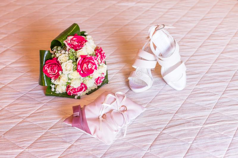 Wedding bouquet, bride shoes and wedding rings. Beautiful bride accessory Wedding bouquet, bride shoes and wedding rings royalty free stock photos
