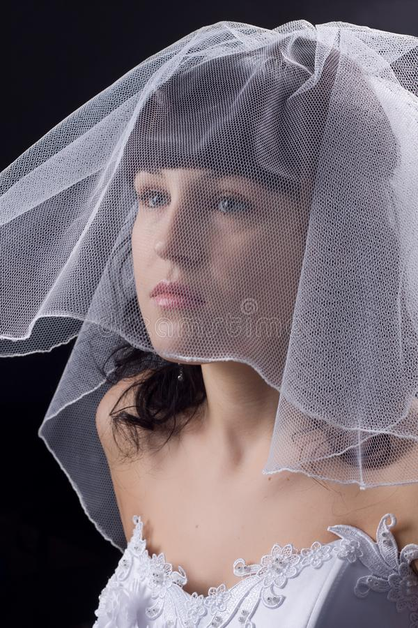 Beautiful  bride against black background