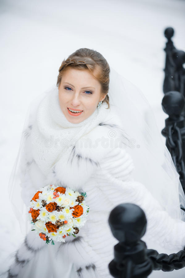 Beautiful bride with big wedding bouquet royalty free stock photo