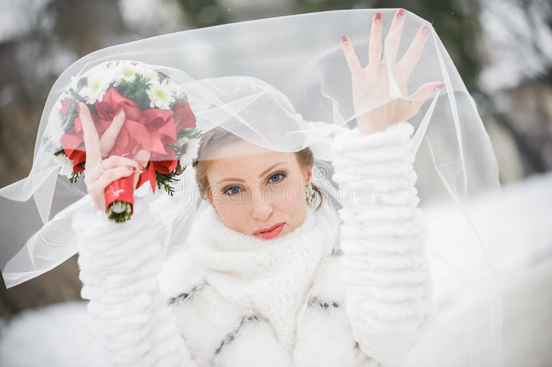 Beautiful bride with big wedding bouquet royalty free stock photography