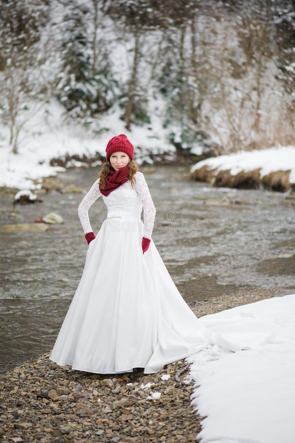 Beautiful bride with big wedding bouquet stock photo