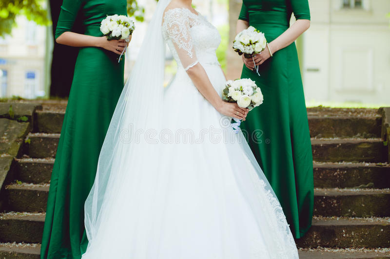 Beautiful bride with big wedding bouquet. Before wedding ceremony in church royalty free stock photos
