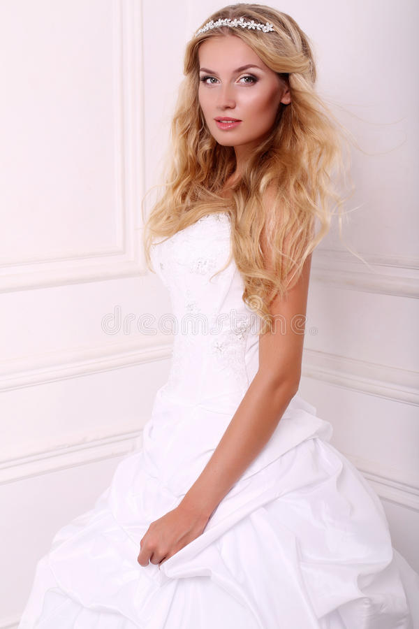 Beautiful bride with blond hair in wedding dress royalty free stock photos