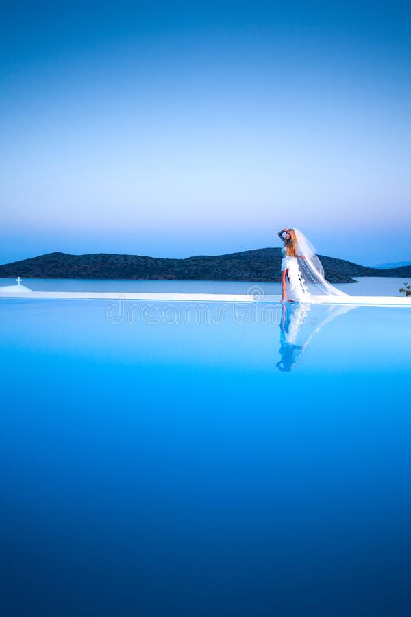 Download Beautiful Bride Blonde Female Model In Amazing Wedding Dress Poses On The Island Of Santorini Stock Photo - Image of church, athens: 105060386