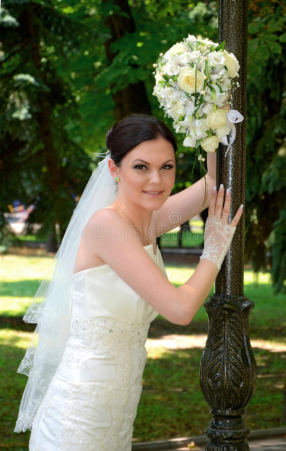 Beautiful bride with a bouquet stock photo