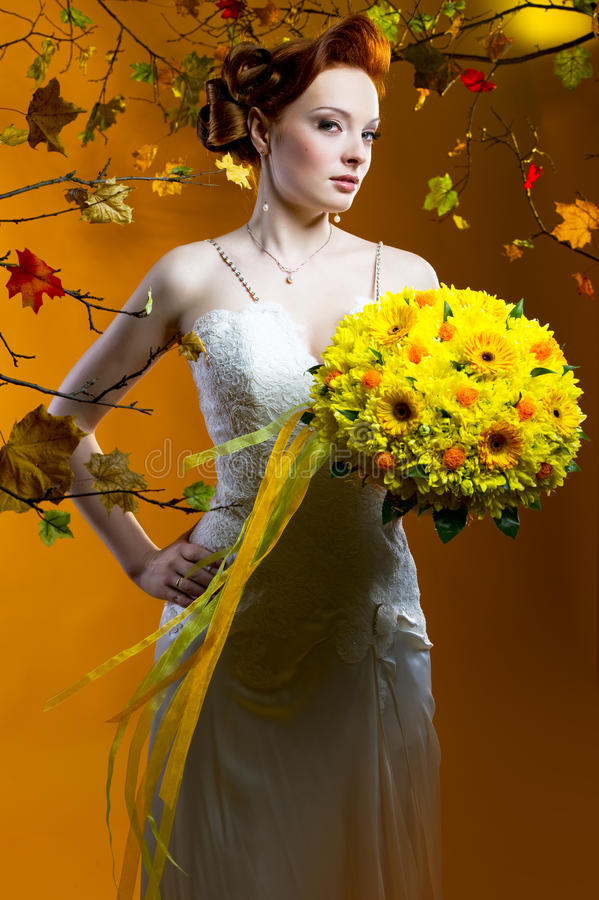 Beautiful bride with a bouquet of flowers stock images