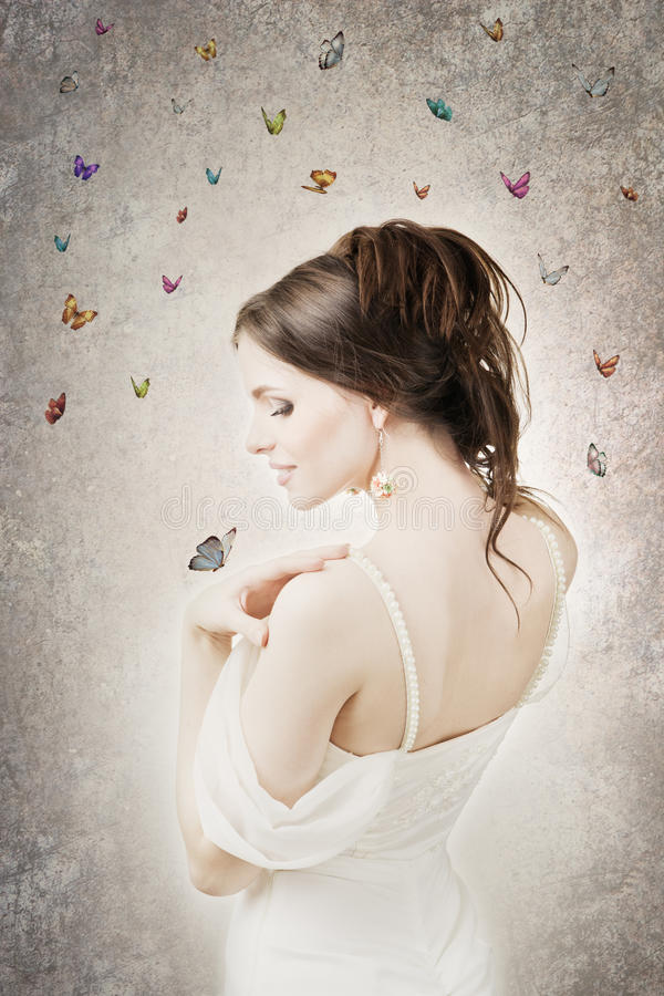 Beautiful bride with butterflies royalty free stock photography