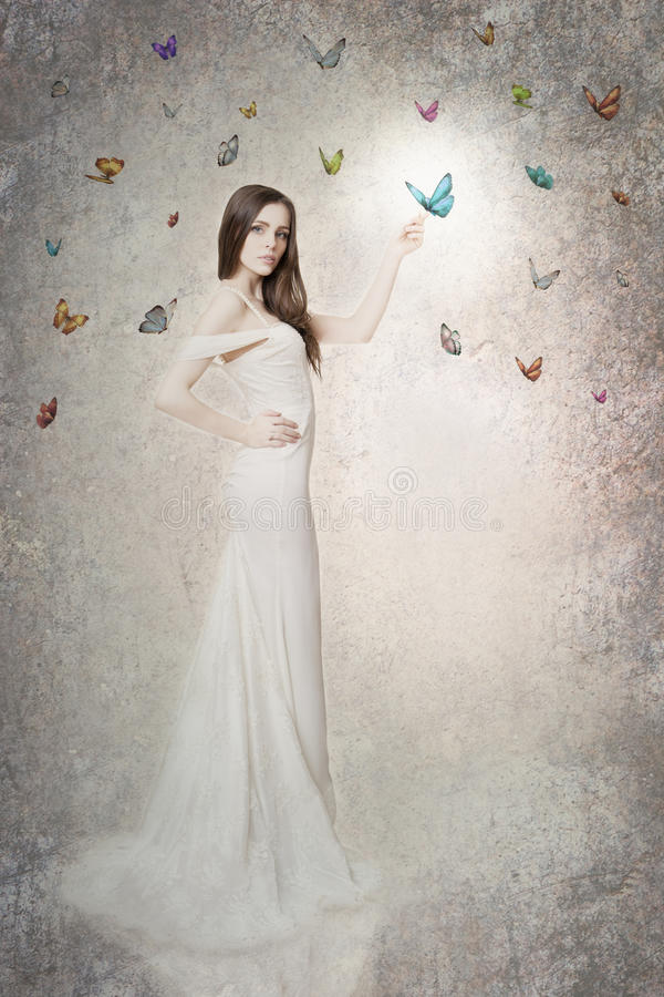 Beautiful bride with butterflies stock photography
