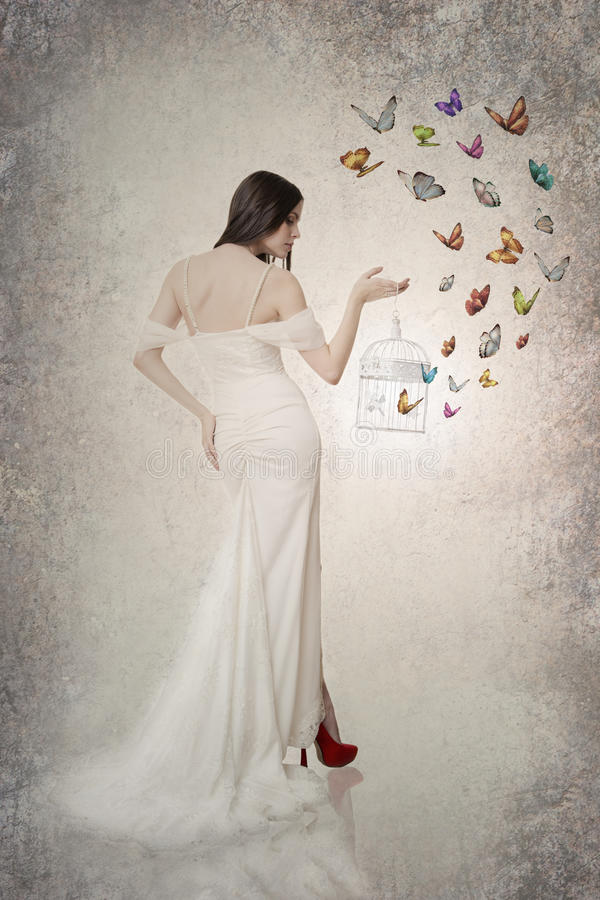 Beautiful bride with butterflies stock photo