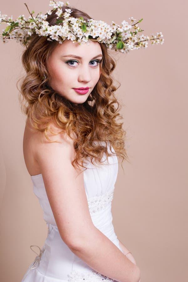 Beautiful bride with cherry wreath stock photos