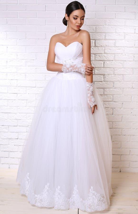 Beautiful Bride With Dark Hair In Elegant Wedding Dress With ...