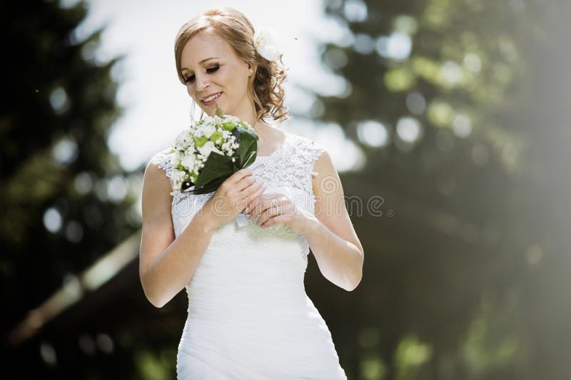 Beautiful bride with flower in hair royalty free stock photo