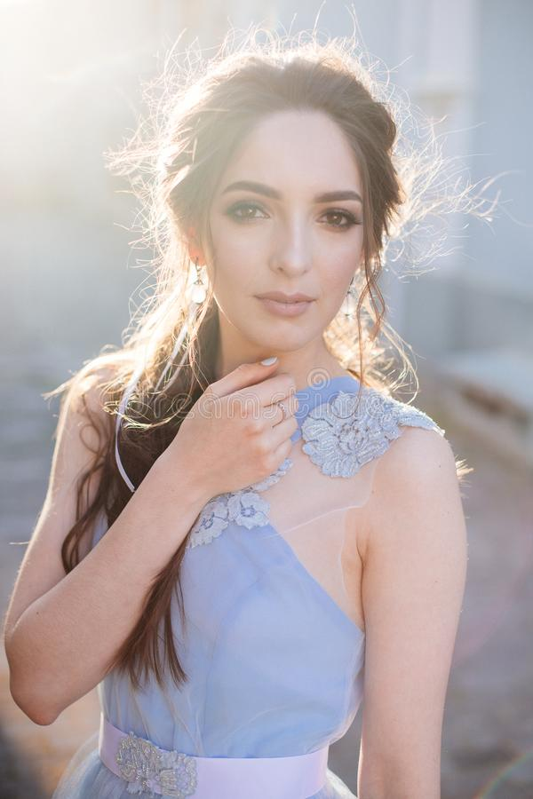 Bride in blue dress. Beautiful bride girl in a blue dress with long hair at sunset stock photos