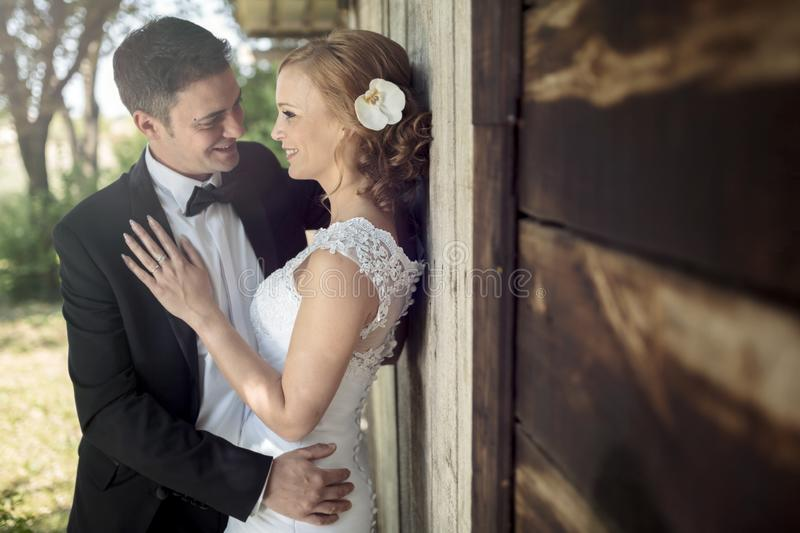 Beautiful bride and groom outdoors royalty free stock photography