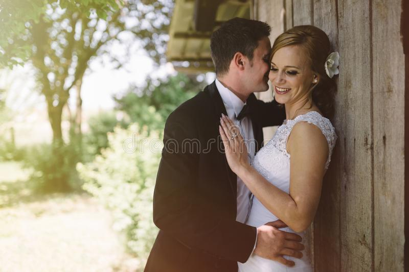 Beautiful bride and groom outdoors royalty free stock images
