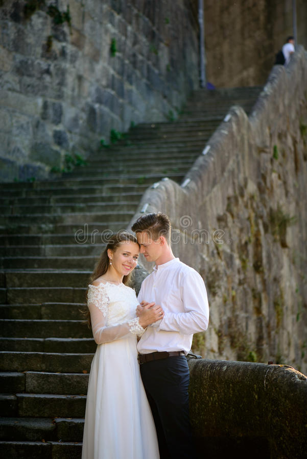 Beautiful bride and groom on the stairs royalty free stock photography