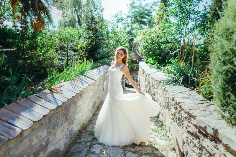 Download Beautiful Bride Having Fun In Nature Stock Photo - Image: 83721872