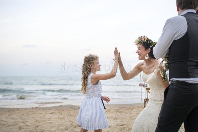 Beautiful bride with her flower girl stock image