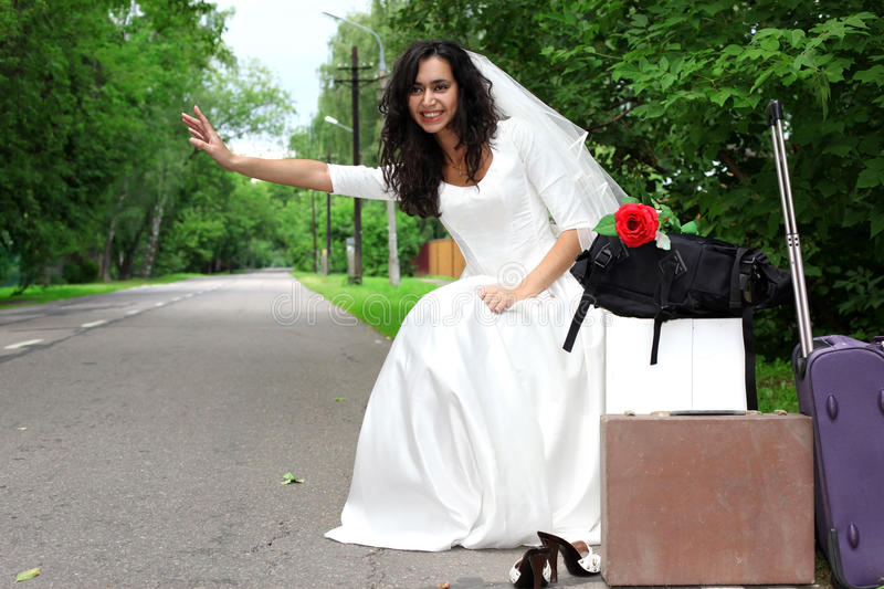 Download Beautiful bride hitch-hike stock photo. Image of colorful - 10384578