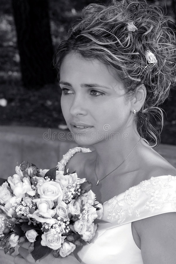 Beautiful bride holding bouquet royalty free stock images