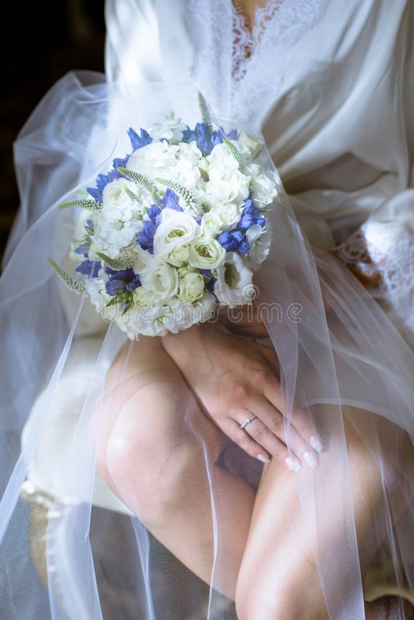 Free Beautiful Bride Is Holding A Wedding Colorful Bouquet Stock Images - 119311474