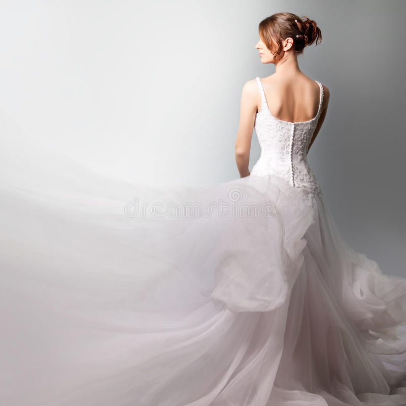 Beautiful bride in a luxurious wedding dress stock photos
