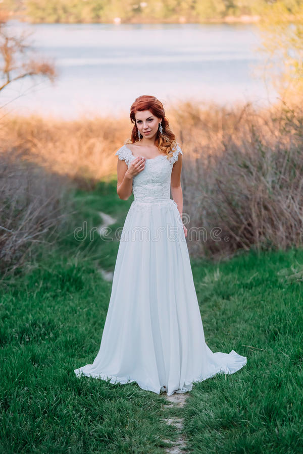 Beautiful bride on nature royalty free stock images