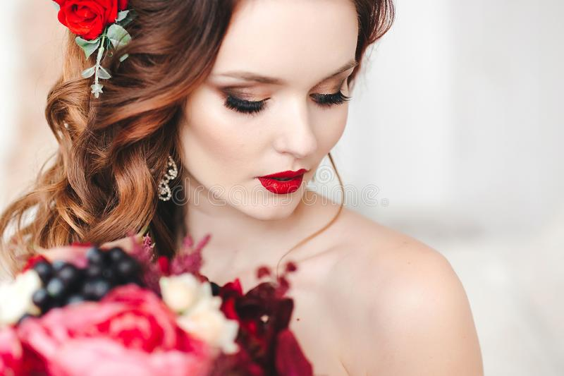 Beautiful bride with an original wedding bouquet in a vintage interior. Beautiful bride with an original wedding bouquet in a vintage interior royalty free stock images