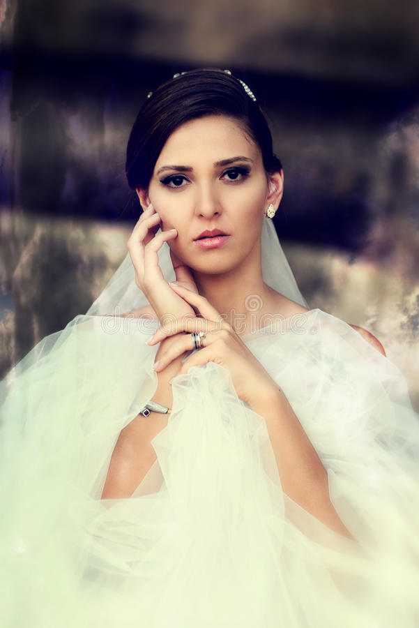 Beautiful bride outdoor. Bride posing before her wedding. caucaisan young woman stock photography
