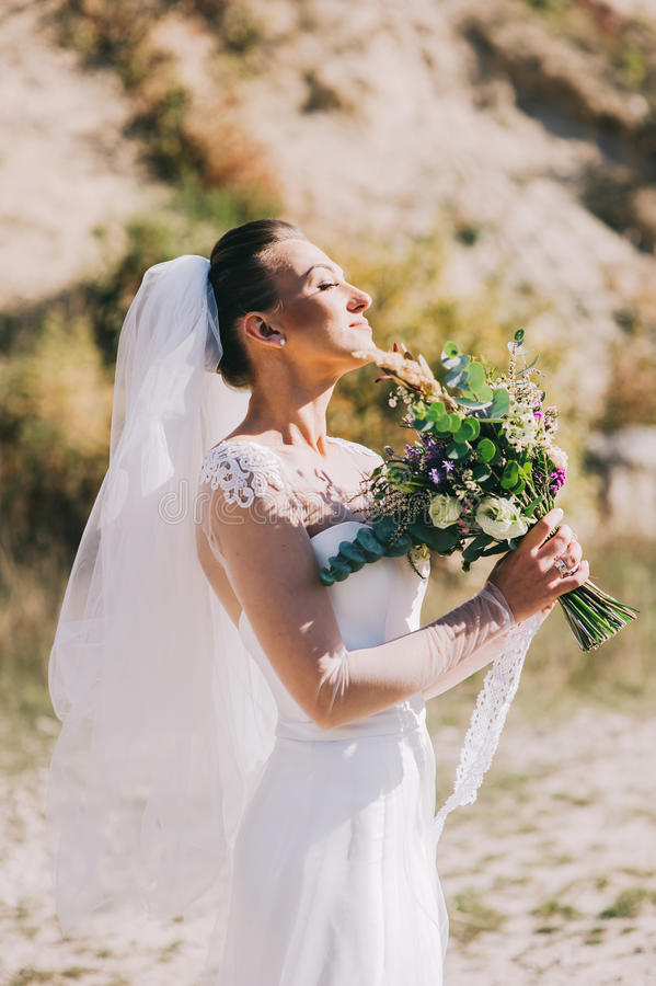 Beautiful bride outdoors stock images